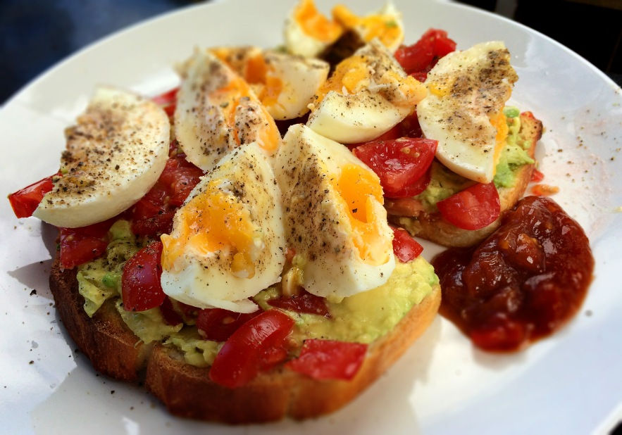avo and tomato on toast with boiled eggs